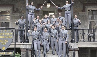 This undated image taken from Twitter shows 16 black, female cadets in uniform with their fists raised while posing for a photograph at the United States Military Academy at West Point, N.Y. ( Photo take from Twitter via AP)
