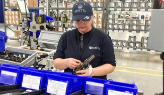 A worker assembles a handgun at the new Beretta plant in Gallatin, Tennessee, on April 15, 2016. The Italian gun maker has cited Tennessee's support for gun rights in moving its production from its plant in Maryland. (Associated Press)