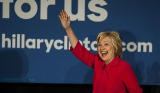 Hillary Clinton waves to the crowd before speaking during a campaign stop in Bowling Green, Ky., on Monday, May 16, 2016. (Austin Anthony/Daily News via AP)