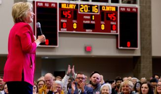 "A score board reads ""Hillary Clinton 2016"" as Democratic presidential candidate Hillary Clinton speaks at a get-out-the-vote event at Transylvania University in Lexington, Ky., Monday, May 16, 2016. (AP Photo/Andrew Harnik)"