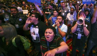 In a Saturday, May 14, 2016 photo, supporters of Democratic presidential candidate Bernie Sanders react as U.S. Sen. Barbara Boxer, D-Calif., speaks during the Nevada State Democratic Party's 2016 State Convention at the Paris hotel-casino in Las Vegas. The Nevada Democratic Convention turned into an unruly and unpredictable event, after tension with organizers led to some Bernie Sanders supporters throwing chairs and to security clearing the room, organizers said. (Chase Stevens/Las Vegas Review-Journal via AP) LOCAL TELEVISION OUT; LOCAL INTERNET OUT; LAS VEGAS SUN OUT