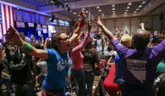 Supporters of Democratic presidential candidate Bernie Sanders react during the Nevada State Democratic Party's 2016 State Convention at the Paris hotel-casino in Las Vegas on May 14, 2016. The Nevada Democratic Convention turned into an unruly and unpredictable event, after tension with organizers led to some Bernie Sanders supporters throwing chairs and security clearing the room, organizers said. (Chase Stevens/Las Vegas Review-Journal via AP)