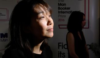 Winner of the 2016 Man Booker International prize for fiction Han Kang speaks to the media after winning the award for her book 'The Vegetarian' after the award ceremony in London, Tuesday, May, 16, 2016. (AP Photo/Alastair Grant)