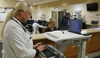 Jennifer Parrott, a certified nurse practitioner, does charting at the Oklahoma Health Sciences Emergency Department, in Oklahoma City, in Oklahoma City, Friday, May 13, 2016. Republican leaders in Oklahoma are moving toward a plan to expand its Medicaid program to bring in billions of federal dollars from President Obama's new health care system. (AP Photo/Sue Ogrocki)