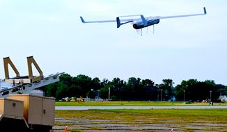 An RQ-21A Blackjack small tactical unmanned aircraft system flies over a field near Naval Air Station Patuxent River, Md., June 12, 2013. (U.S. Navy)