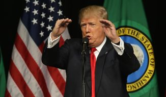 In this May 7, 2016 file photo, Republican presidential candidate Donald Trump speaks during a rally in Spokane, Wash. Trump is moving quickly to install political operatives in more than a dozen states, targeting Maine and Minnesota among others that traditionally favor Democrats, as the Republican White House contender lays the groundwork for an expanded electoral battlefield.  (AP Photo/Ted S. Warren, File)
