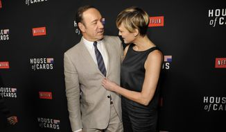 "In this Feb. 13, 2014, file photo, Kevin Spacey, left, and Robin Wright arrive at a special screening for season 2 of ""House of Cards"" in Los Angeles. (Photo by Chris Pizzello/Invision/AP, File)"