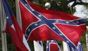 In this July 19, 2011 file photo, Confederate battle flags fly in Mountain Creek, Ala. (AP Photo/Dave Martin, File)