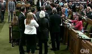 Canadian Prime Minister Justin Trudeau has apologized after he was accused of manhandling a Conservative member of Parliament and elbowing a female lawmaker in the ribs during a chaotic exchange in the House of Commons Wednesday afternoon. (CTV via CNN)