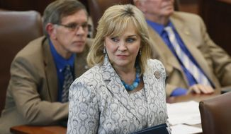 Oklahoma Gov. Mary Fallin walks on the floor of the Oklahoma House in Oklahoma City in this May 18, 2016, photo. Gov. Fallin has vetoed legislation that would make it a felony for doctors to perform an abortion, a measure that would have effectively outlawed the procedure in the state. (AP Photo/Sue Ogrocki, File)