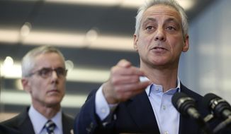 **FILE photo** Chicago Mayor Rahm Emanuel, right, responds to a question related to the massive delays at airport security lines across the country, as Transportation Security Administration chief Peter Neffenger listens Friday, May 20, 2016, in Chicago. (AP Photo/Charles Rex Arbogast)