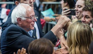 Democratic presidential candidate Bernie Sanders, left, greets supporters after making a speech Friday, May 20. 2016, in Albuquerque, N.M.  (Roberto E. Rosales/The Albuquerque Journal via AP)
