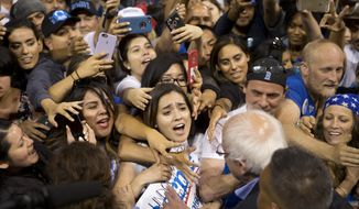 FILE - In this May 17, 2016 file photo, Democratic presidential candidate Sen. Bernie Sanders, I-Vt., greets supporters after speaking at a rally in Carson, Calif.  Bernie Sanders' campaign is mining deep into voter data from Hispanic enclaves, scouting for hidden supporters in an effort to undercut Hillary Clinton in a contest that he has vowed to fight to the end. Clinton ran up a 2-1 advantage with Hispanics in her 2008 win in California over Barack Obama and is making a strong push to do that again.  (AP Photo/Jae C. Hong)