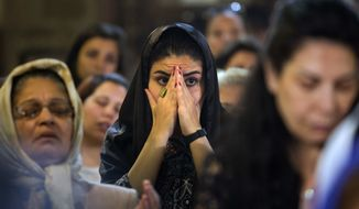 Coptic Christians attend prayers for the departed, remembering the victims of EgyptAir flight 804 at Al-Boutrossiya Church, in the main Coptic Cathedral complex, Cairo, Egypt, Sunday, May 22, 2016. (AP Photo/Amr Nabil) ** FILE **