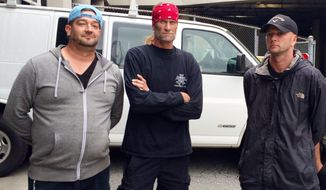 HOLD FOR STORY BY ANNA GONEWOLD- In this May 19, 2016 photo, Kery Eller, left, Stephen Willard and Stephen Eller, right, take a smoke break outside the Greensboro Coliseum Complex in Greensboro, N.C. ,where they are setting up for a trade show. The three men work as stage hands with the local union of International Alliance of Theatrical Stage Employees. Kery Eller estimates in the past two months he has lost nearly $3,000 he expected to earn working at shows that were canceled by artists protesting the state's law limiting anti-discrimination policies for LGBT individuals. (AP Photo/Anna Gronewold)
