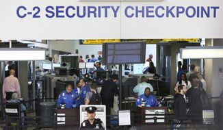 Transportation Security Administration agents work at a security checkpoint in terminal C at Newark Liberty International airport Monday, May 23, 2016, in Newark, N.J. Earlier Monday, it was announced that the TSA is adding over 100 more agents by next month. (AP Photo/Mel Evans)