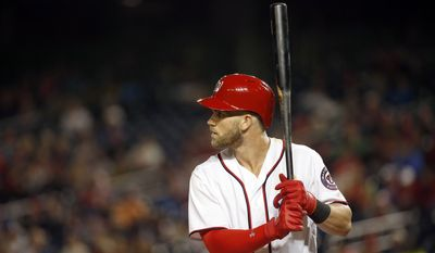 Washington Nationals right fielder Bryce Harper (34) bats during a baseball game against the New York Mets at Nationals Park, Monday, May 23, 2016, in Washington. The Mets won 7-1. (AP Photo/Alex Brandon)