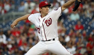 Washington Nationals starting pitcher Stephen Strasburg throws during the third inning of a baseball game against the New York Mets at Nationals Park, Tuesday, May 24, 2016, in Washington. (AP Photo/Alex Brandon)