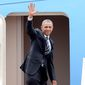 U.S. President Barack Obama waves as he boards Air Force One upon his departure from Noi Bai international airport in Hanoi, Vietnam, Tuesday, May 24, 2016. Obama is in Vietnam on a three-day visit. (AP Photo/Duong Minh Hoang)