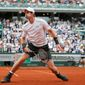 Britain's Andy Murray exhales after sprinting to return the ball in his French Open second-round victory over Mathias Bourgue on Wednesday. (Associated Press)