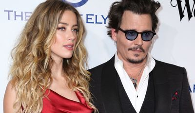 Amber Heard and Johnny Depp arrive at The Art of Elysium's Ninth annual Heaven Gala at 3LABS on Jan. 9 in Culver City, Calif. (Associated Press)