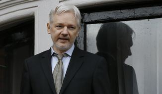 In this Friday Feb. 5, 2016 file photo, Wikileaks founder Julian Assange speaks from the balcony of the Ecuadorean Embassy in London. (AP Photo/Kirsty Wigglesworth, File)