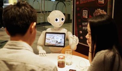 "Pizza Hut and MasterCard have teamed up to deploy Softbank's humanoid robot ""Pepper"" in select restaurants in Asia by the end of the year. (MasterCard)"