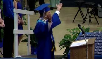 Graduating high school students in East Liverpool, Ohio, spontaneously recited The Lord's Prayer at their commencement Sunday after their school board caved to atheists' demands. Valedictorian Jonathan Montgomery, pictured here, led the prayer.