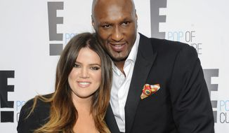 "Khloe Kardashian Odom and Lamar Odom from the show ""Keeping Up With The Kardashians"" attend an E! Network upfront event at Gotham Hall in New York on April 30, 2012. (Associated Press)"