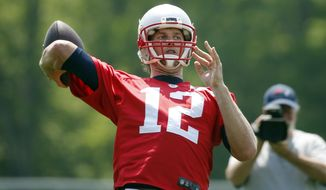 New England Patriots quarterback Tom Brady passes during an NFL football practice Thursday, May 26, 2016, in Foxborough, Mass. (AP Photo/Michael Dwyer)