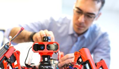 Technology giant Siemens is working on swarming spider-robots that are capable of 3D printing large-scale projects. (Siemens)