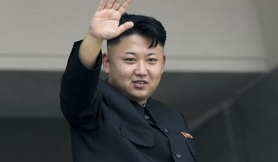 """FILE - In this July 27, 2013 file photo, North Korea's leader Kim Jong Un waves to spectators and participants of a mass military parade celebrating the 60th anniversary of the Korean War armistice in Pyongyang, North Korea. President Barack Obama is """"recklessly"""" spreading rumors of a Pyongyang-orchestrated cyberattack of Sony Pictures, North Korea says, as it warns of strikes against the White House, Pentagon and """"the whole U.S. mainland, that cesspool of terrorism."""" (AP Photo/Wong Maye-E, File)"""