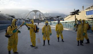 "In this Tuesday, Jan. 26, 2016 photo, health workers get ready to spray insecticide to combat the Aedes aegypti mosquitoes that transmits the Zika virus, under the bleachers of the Sambadrome in Rio de Janeiro, which will be used for the Archery competition in the 2016 summer games. More than 145 public health experts signed an open letter to the World Health Organization on Friday, May 27, 2016 asking the U.N. health agency to consider whether the Rio de Janeiro Olympics should be postponed or moved because of the ongoing Zika outbreak. The letter calls for the games to be delayed or relocated ""in the name of public health."" (AP Photo/Leo Correa, File)"