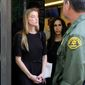 Actress Amber Heard leaves Los Angeles Superior Court court on Friday, May 27, 2016, after giving a sworn declaration that her husband Johnny Depp threw her cellphone at her during a fight Saturday, striking her cheek and eye. (AP Photo/Richard Vogel) ** FILE **