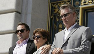 In this Sept. 1, 2015, file photo, from left, Brad Steinle, Liz Sullivan and Jim Steinle, the brother, mother and father of Kate Steinle who was shot to death on a pier, listen to their attorneys speak during a news conference on the steps of City Hall in San Francisco. (AP Photo/Eric Risberg, File)