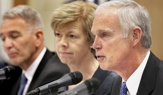 "FILE - In this March 31, 2015 file photo, U.S. Sen. Ron Johnson, R-Wis., right, speaks during a Joint Hearing of the Committee on Homeland Security and Governmental Affairs of the U.S. Senate and the Committee on Veterans' Affairs of the U.S. House of Representatives in Tomah, Wis. Johnson, in the midst of a tough re-election battle, plans to release a report Tuesday May 31, 2016 detailing a Senate committee's yearlong investigation into a drug scandal at Tomah's Veterans Affairs medical facility known as ""Candy Land."" (Erik Daily/La Crosse Tribune, via AP File)  MANDATORY CREDIT"