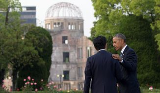 President Obama and Japanese Prime Minister Shinzo Abe speak at the Hiroshima Peace Memorial Park in Hiroshima, Japan on Friday. Mr. Obama's visit was criticized by the left and the right. Some said his rhetoric does not match his actions and others said his speech sounded like an apology. (Associated Press)