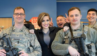 Miss America 2016 Betty Cantrell has a moment with airmen during a USO stop at Joint Base Elmendorf-Richardson, Alaska. (U.S. Air force)