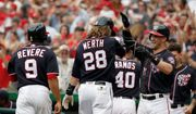 Washington Nationals' Jayson Werth celebrates his pinch-hit grand slam with Bryce Harper in the seventh inning of their 10-2 win over the St. Louis Cardinals. Werth spent much of the game in the batting cage fine-tuning his swing on a scheduled day off after hitting just .220 entering Sunday. (Associated Press)