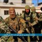 """This file image posted on the Twitter page of Syria's al-Qaida-linked Nusra Front on Friday, April 1, 2016, shows fighters from al-Qaida's branch in Syria, the Nusra Front, marching toward the northern village of al-Ais in Aleppo province, Syria. Al-Qaida's branch in Syria has recruited hundreds of new fighters, including teenagers, and taken territory from government forces in a successful offensive in the north, illustrating how the cease-fire put in place by Russia and the United State to weaken the militants has in many ways backfired. Arabic, bottom, reads, """"Mujahedeen getting ready to attack the enemies of God in al-Ais."""" (Al-Nusra Front via AP, File)"""