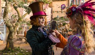"""FILE - In this image released by Disney, Johnny Depp, left, and Mia Wasikowska appear in a scene from """"Alice Through The Looking Glass."""" (Peter Mountain/Disney via AP, File)"""