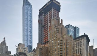 "A luxury 90-floor apartment skyscraper called ""One57,"" left, rises above all other buildings overlooking Central Park, while a crane sits atop ongoing construction for a new condominium skyscraper at 220 Central Park South, Thursday May 26, 2016, in New York. A penthouse in One57 went for $100.5 million in 2014, but an apartment in the new condominium is expected to sell for $250 million. (AP Photo/Bebeto Matthews)"