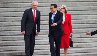 Chinese Premier Li Keqiang welcomed Australian Prime Minister Malcolm Turnbull and his wife, Lucy, to Beijing in April. The delicate relationship between their countries is about to change. (Associated Press)