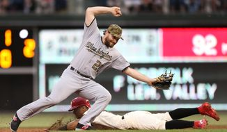 Philadelphia Phillies' Cesar Hernandez is safe on a steal at second base as Washington Nationals second baseman Daniel Murphy (20) misses the throw with with Tyler Goeddel at bat in the second inning of a baseball game, Monday, May 30, 2016, in Philadelphia. (AP Photo/Laurence Kesterson)