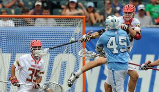 University of North Carolina's Chris Cloutier (45) shoots and scores on University of Maryland goalie Lyle Bernlohr (35) as Maryland teammate Matt Dunn, right, also defends during the NCAA Division 1 men's lacrosse final in Philadelphia, Monday, May 30, 2016.(Clem Murray/The Philadelphia Inquirer via AP)  PHIX OUT; TV OUT; MAGS OUT; NEWARK OUT; MANDATORY CREDIT