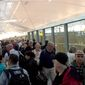 Passengers wait in a long Transportation Security Administration security line at New York's John F. Kennedy International Airport during the morning rush on Monday, May 9, 2016. (AP Photo/Scott Mayerowitz) ** FILE **