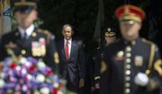 President Barack Obama, center, arrives with Maj. Gen. Bradley A. Becker, right, for the wreath laying ceremony at the Tomb of the Unknowns, on Memorial Day, Monday, May 30, 2016, at Arlington National Cemetery in Arlington, Va. (AP Photo/Pablo Martinez Monsivais)