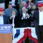 Sen. Jeff Sessions appears at the podium onstage with Donald Trump at a Trump campaign rally in Alabama. (Associated Press)