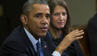 Secretary of Health and Human Services Sylvia Mathews Burwell (right) looks on as President Obama delivers remarks during a meeting with people that wrote him letters explaining how they benefited from the Affordable Care Act in the Roosevelt Room of the White House on Feb. 3, 2015. (Associated Press) **FILE**