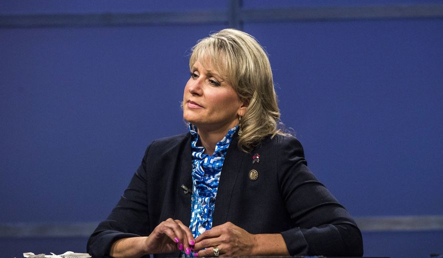 In this Thursday, May 19, 2016 photo, Rep. Renee Ellmers listens while facing off with Dr. Greg Brannon and Rep. George Holding during the 2nd Congressional District Republican primary debate at WRAL studio in Raleigh, N.C. (Travis Long/The News & Observer via AP, Pool)